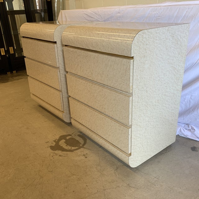 Fair marble laminate finish in excellent condition with brass trim in between drawers. Drawers slide beautifully. Best...