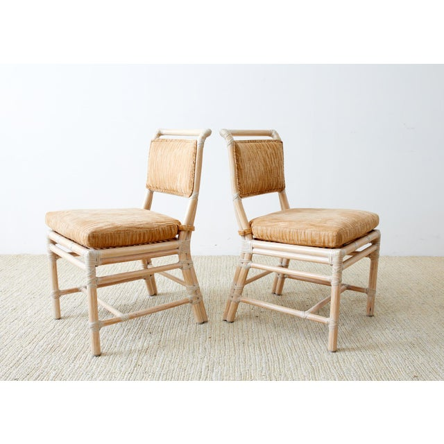 Stylish set of nine McGuire bamboo rattan dining chairs featuring a light cerused finish. Set consists of eight dining...