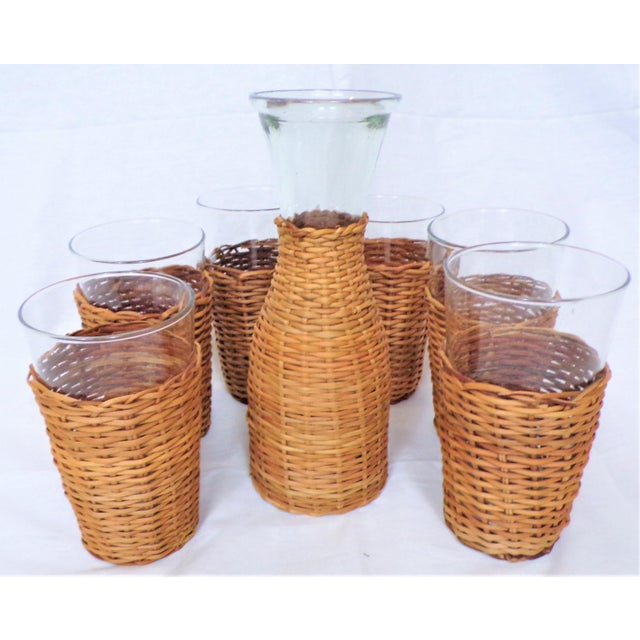 This is a fantastic set of rattan wrapped glassware. This set is a simple set of glass serving pieces all wrapped with...