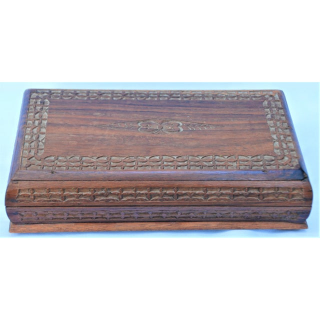 Beautiful vintage wooden jewelry box. Nice carved detailing and footed base. Perfect for storing all your baubles!!! Great...