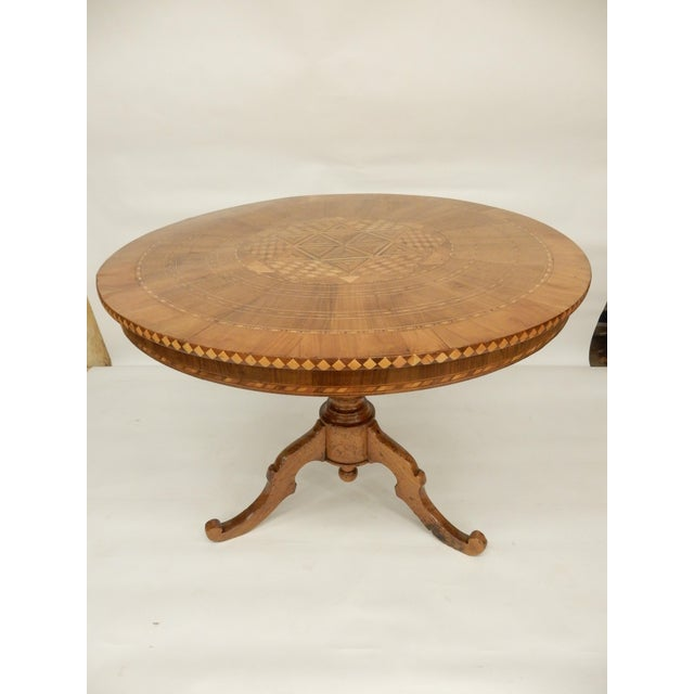 Intricate inlaid 19th century Italian walnut round pedestal table. It would make a lovely center hall table or and accent...
