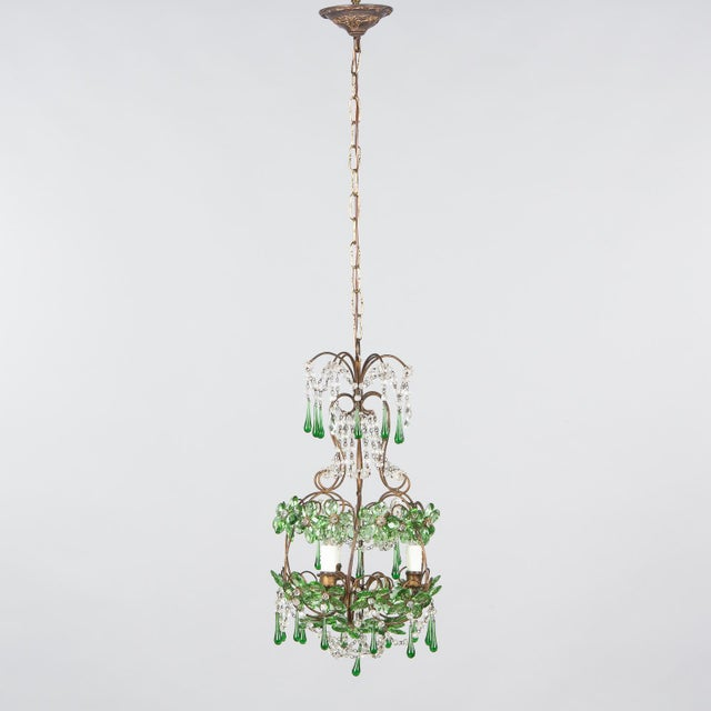 A vibrant green glass and crystal chandelier, French circa 1920. This piece brings a hit of color as well as illumination....
