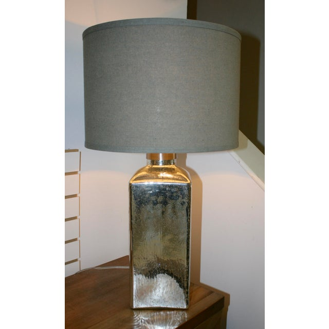 Textured mercury lamps with shades.