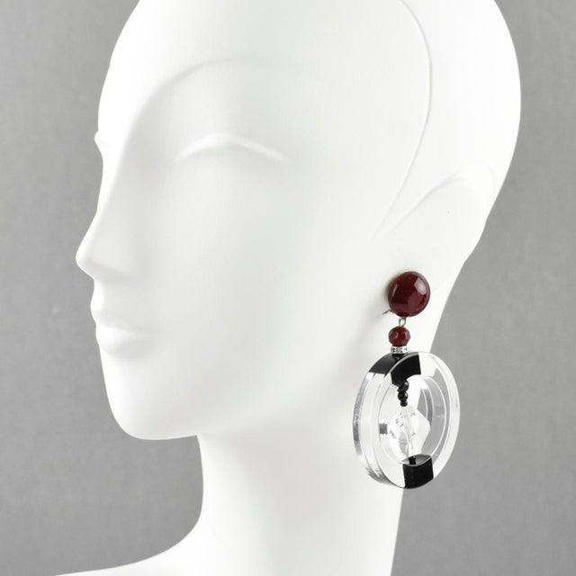 Stunning Angela Caputi, made in Italy resin clip on earrings. Oversized dangling design with large crystal clear hoop...