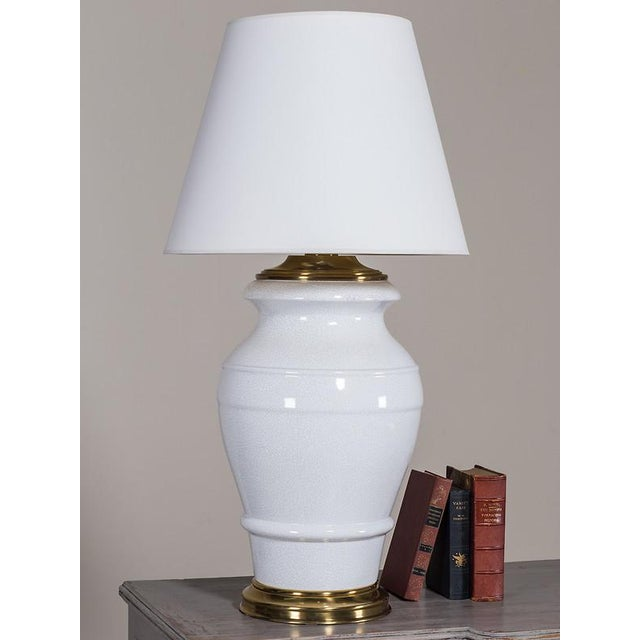 This marvelously over scaled porcelain lamp was made by the Paul Hanson Lamp Company and dates from the 1950's. Please...