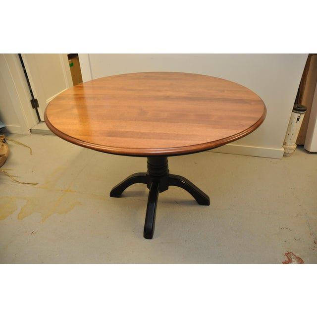 Shermag Company pedestal dining table, made in Canada. Extendable from circle to oval with one leaf. Sturdy, solid,...