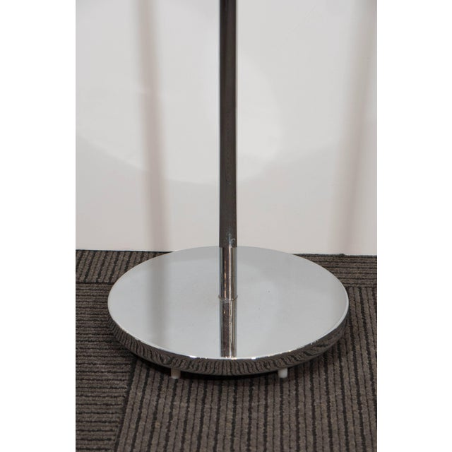 This reading floor lamp, produced circa 1970s by Casella, comes in polished chrome, the shade supported by an adjustable...