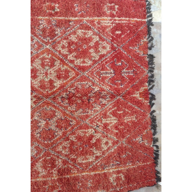 The large, archaic looking, white-ground rug known as the beni Mguild is the creation of Morroco's mountain nomads. The...