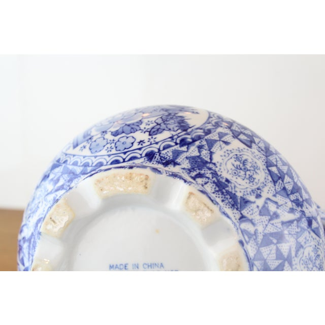 Decorative Chinese bowl in blue and white geometric pattern hand painted porcelain.