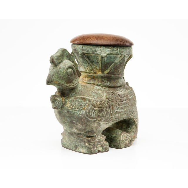 This patinated rooster vase is a verdigris bronze piece with archaic Chinese motif. This creation was designed by Lucia...