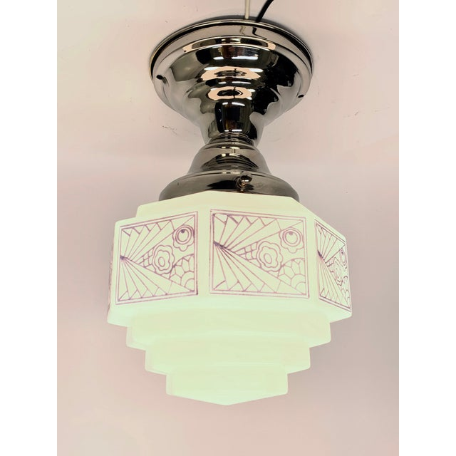 Lovely small stair stepped Skyscraper design globe in a new (reproduction) polished nickel semi flush fixture. UL Listed....