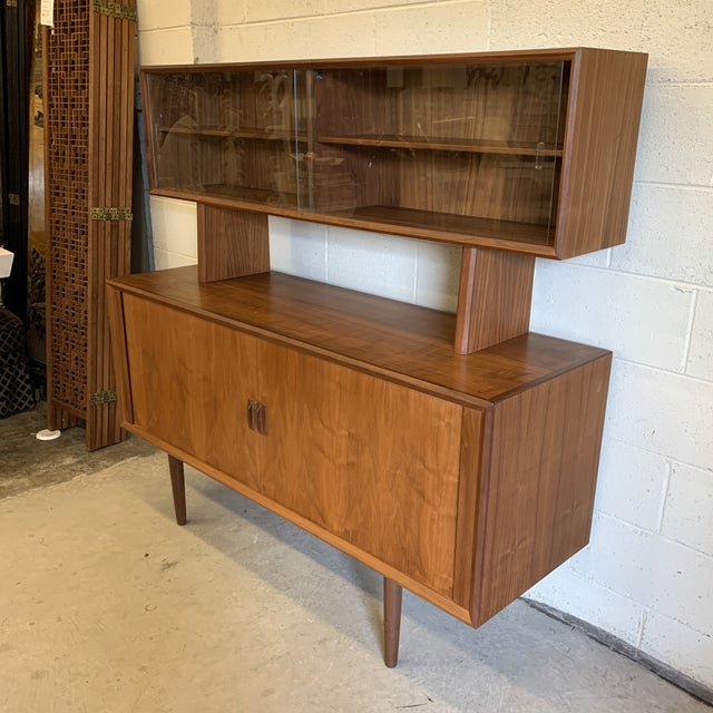 This is a two piece unit and this listing is for both pieces. I am, however listing just the top bookcase glass front...