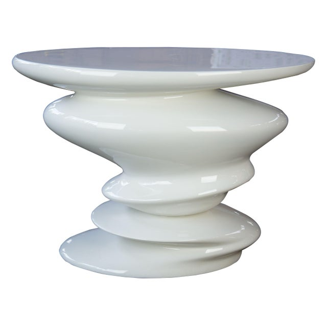 Roche Bobois Sismic end table. By Design Cedric Ragot. The Sismic end table is simple yet elegant with a glossy white finish.