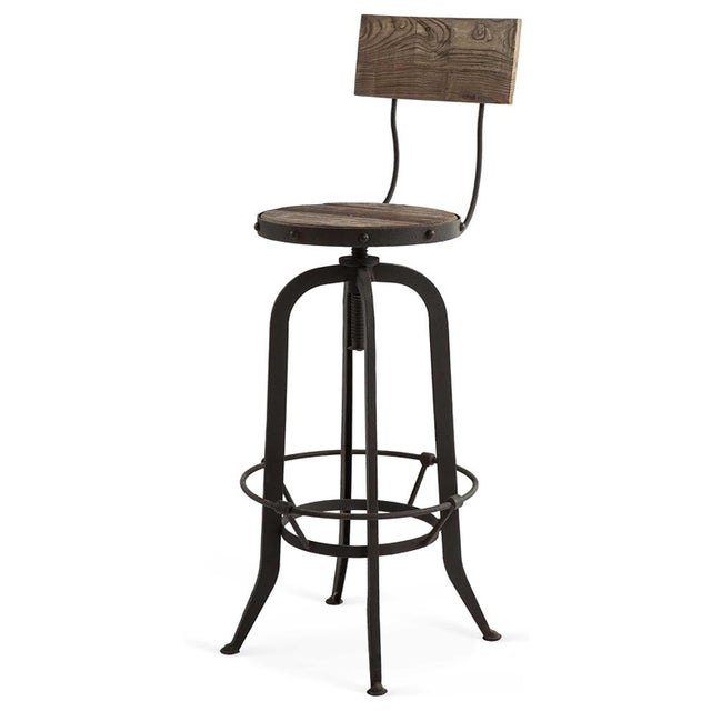 Purchased for a client from Kathy Kuo Home, these handsome, vintage-style bar stools are crafted from reclaimed oak for a...