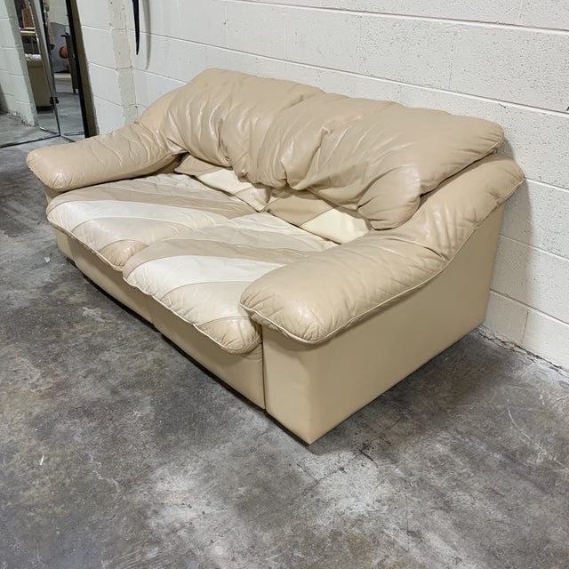 The 80s are back, baby! Groovy leather loveseat with stripes tan, cream and taupe colors on the seat. Really cool and...