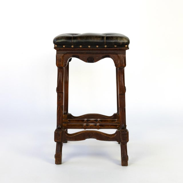 Arts and Crafts Period square upholstered stool, beautifully carved apron, legs and stretchers with nailhead trim, English...