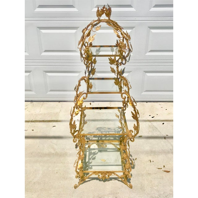 Stunning 1940's etagere. In a French Provincial style and made in Italy. Features four square shelves that get larger...