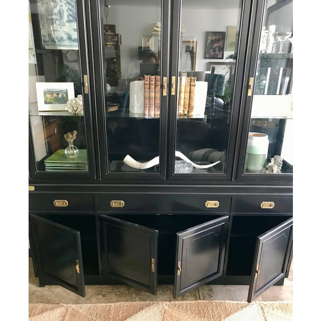 Antique 1920's display cabinet by Kroehler of Canada. Refinished in black lacquer. Original campaign hardware. Working...