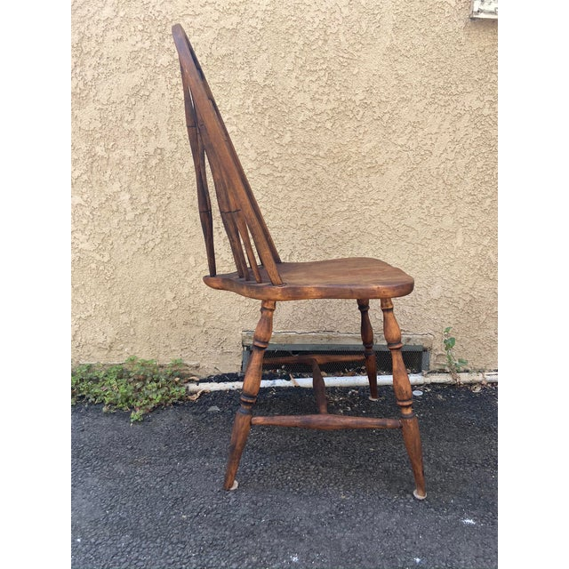 A charming and classic antique Windsor chair, the perfect accessory when a side chair is needed to fill in a corner or...