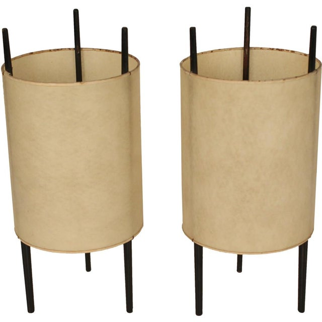 """A set of three """"Cylinder"""" table lights each comprising three cherrywood supports and fiberglass-reinforced polyvinyl..."""