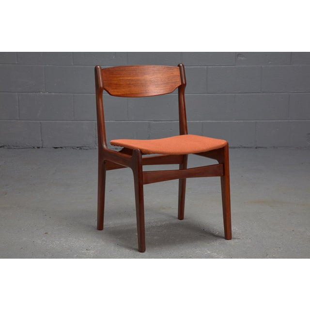 Teakwood Frames And Orange Wool Upholstered Seats Are Featured In This Set Of Dining Chairs