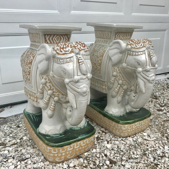 Vintage pair of ceramic elephant garden stools. Glazed white elephants on green bases with unusual turquoise paint accents...