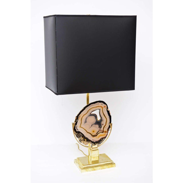 Table lamp influenced by Willy Daro. Brass base displaying a finely polished agate. Wired for the U.S. and in perfect...