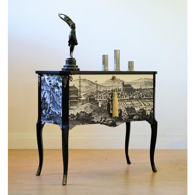 Antique Gustavian commode featuring a 17th century fine line black scenic reproduced drawing of a historic Swedish town on...