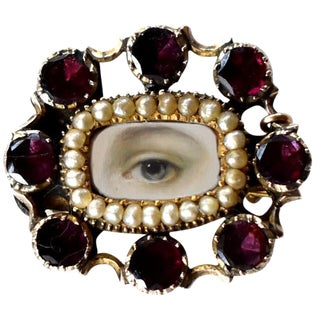 Early 19th Century Lover's Eye Georgian Garnet and Seed Pearl Brooch With Safety Pin For Sale