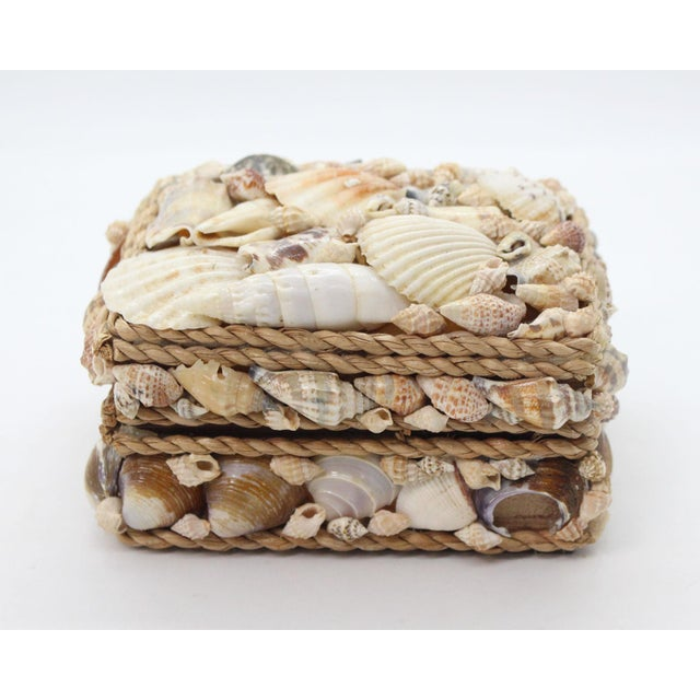Vintage shell and rope encrusted coastal-themed trinket box.