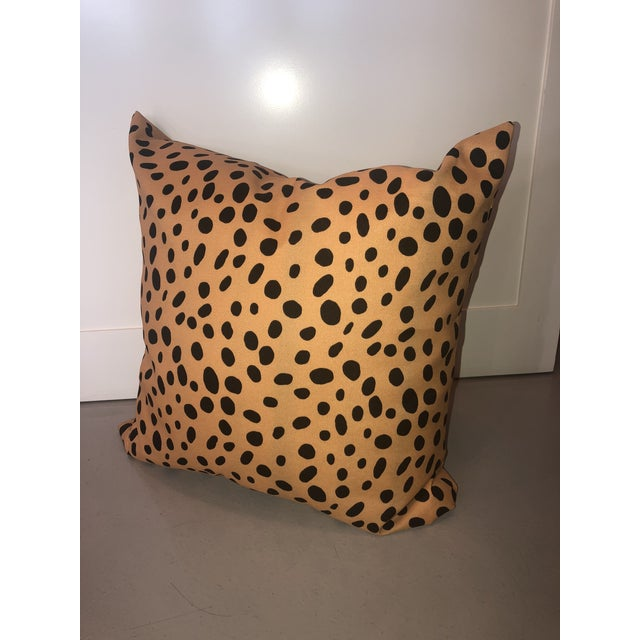 Tan and black animal spotted printed pillows. Contemporarily made.