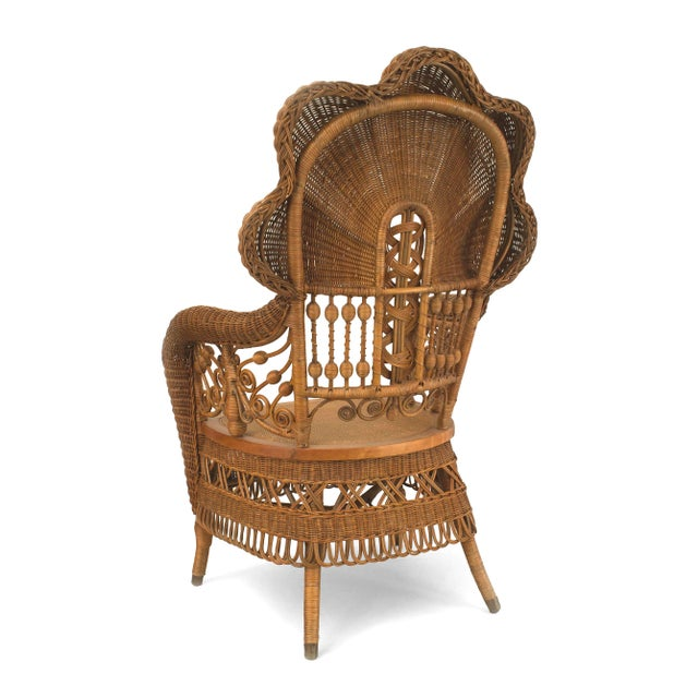 American Victorian natural wicker arm chair with fan shaped back with scroll and filigree design. (Heywood Brothers)