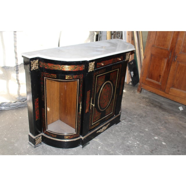 Unique French Boulle cabinet with dual-sided glass doors and a marble top. It is beautifully inlaid with engraved brass...
