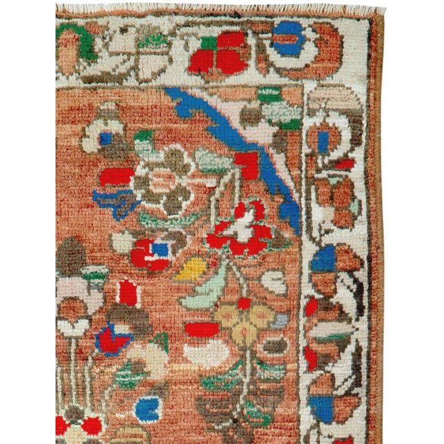 A vintage Persian Hamadan rug. In a style reminiscent of Sarouks and Lilihans, this rustic ruglet shows floral bunches and...