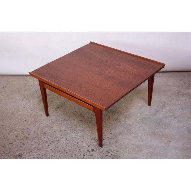 This teak table (not a perfect square, but close to) was designed in the 1950s by Finn Juhl for France and Daverkosen...