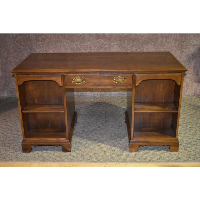 Unique double sided desk. The brand is Ethan Allen. This desk has an Early American style. Made of maple. The color is...