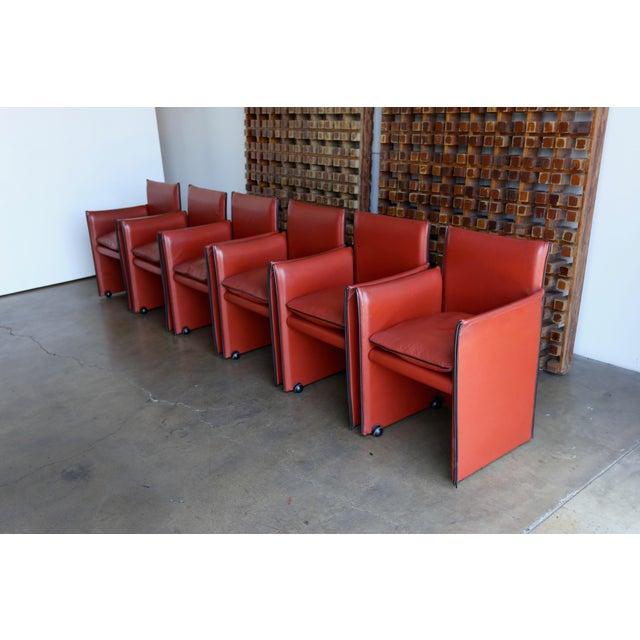 Set of six 'Break' leather armchairs by Mario Bellini.