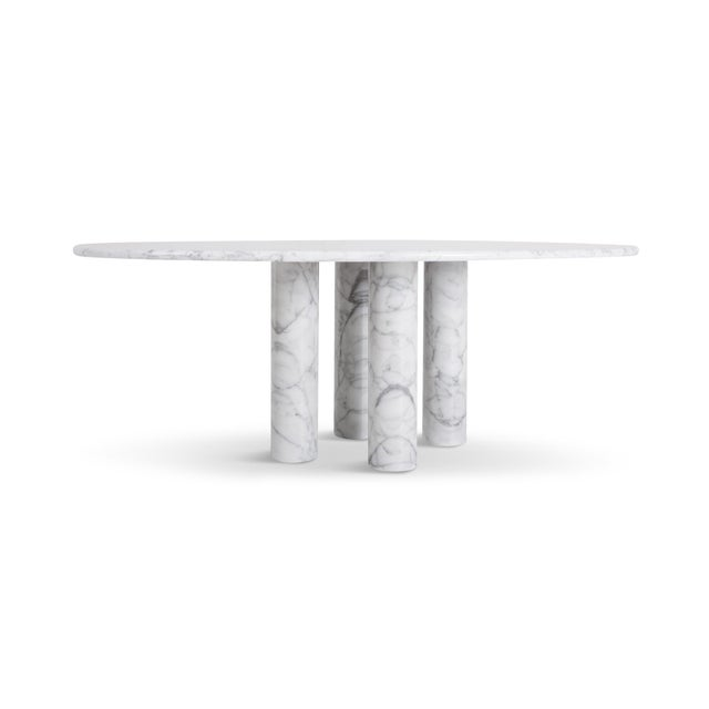 Cassina produced this Il Colonnata dining table by Mario Bellini in Italy 1977. A forest of massive primordial columns....