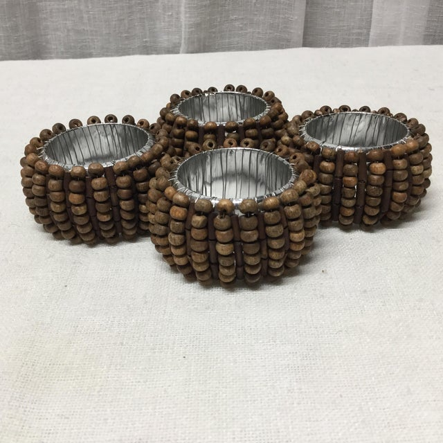 Funky little wooden beads make these napkin rings fun to use. You can dress your table up with them or use them for casual...
