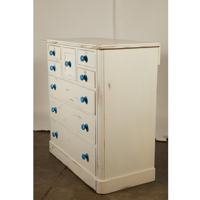 English Painted Chest of Drawers with Blue Knobs 2,250.00 This English pine chest of drawers has been painted in a white...