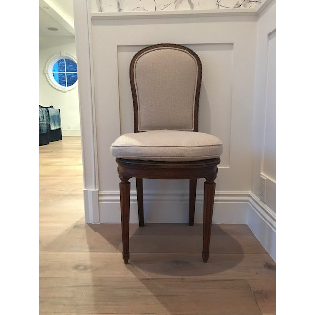Two antique dining chairs. Wood base - upholstered in flax belgian linen. Seat cushion is detachable. Originally from...