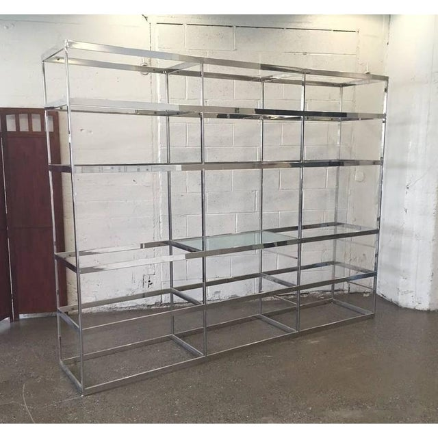 Eight feet, chrome etagere with glass shelves. This unit is in one piece. Does not break down. There is a total of 18...