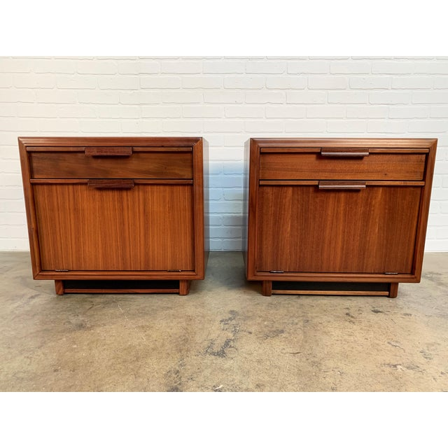 John Keal for Brown Saltman walnut nightstands with fold down door.