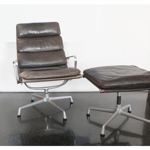 Soft Pad Brown Leather Aluminum Group Chair with matching ottoman. It was designed by Charles and Ray Eames for Herman...