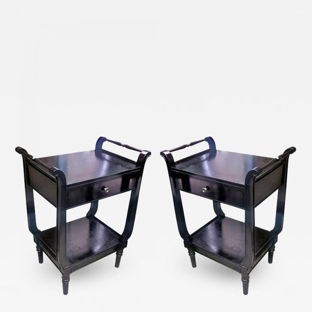 MAISON JANSEN Pair of black neoclassic 1940s bedsides or side tables.