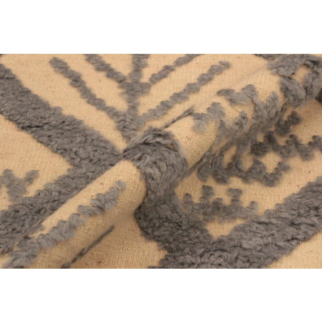Make a statement in your home with this meticulously hand-knotted high-low pile Moroccan wool rug. An intricate design...