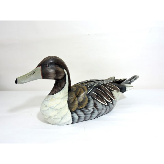 Hand made and hand painted wooden decoy wood-duck made in the 1970's. Pretty colours and detailed painting throughout with...