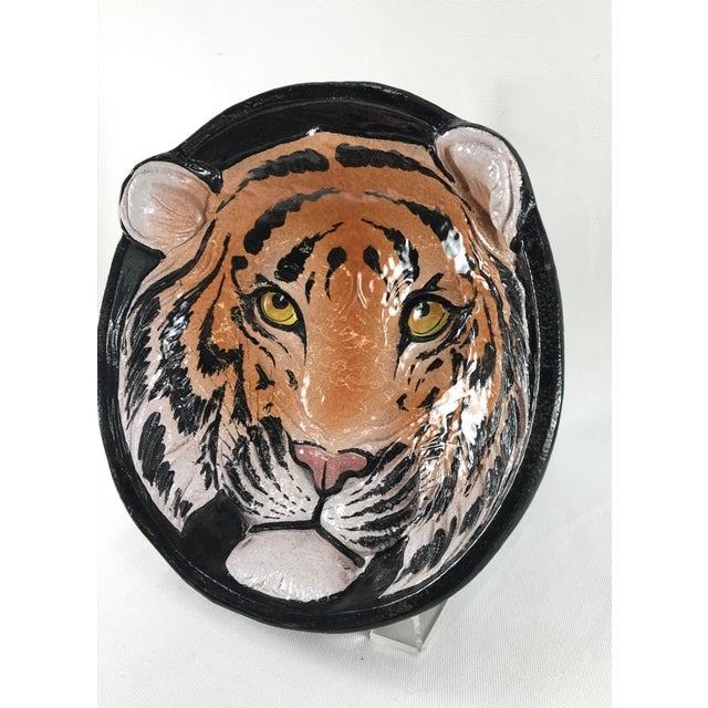 Vintage 1970's carved relief tiger face decorative art pottery dish or bowl with mounting hardware at the back. Glazed on...