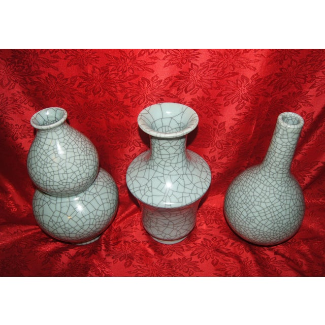 Up for consideration are three, antique or vintage, Chinese Celadon Crackle Vases. The bottle vase is approximately 12...