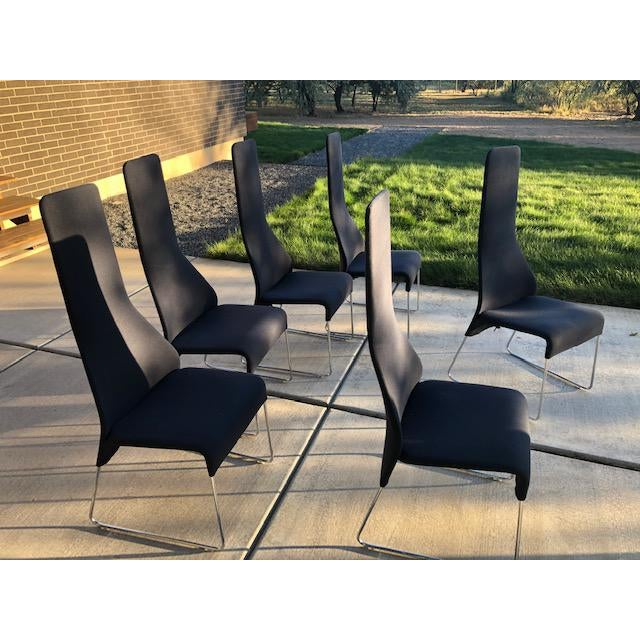 Six navy blue B&B Italia dining chairs. Fabric is in good shape, but not new by any means. The chairs frame wise are in...